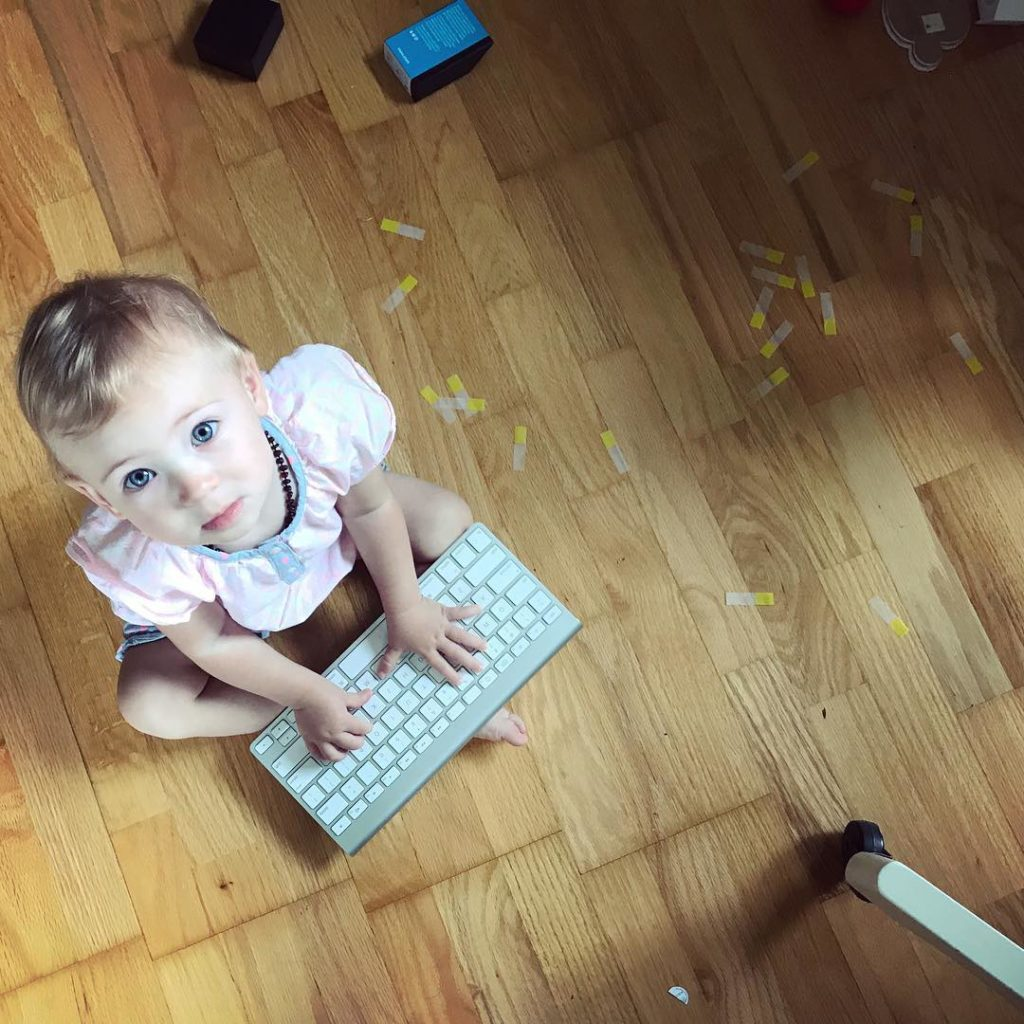Toddler entertainment PostIt flags and a dead Apple keyboard hellip
